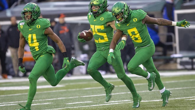 Oregon defensive backs Thomas Graham Jr. (4), Brady Breeze and Jevon Holland (8) are all hoping to go in this week's NFL draft.