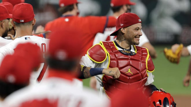 St. Louis Cardinals catcher Yadier Molina, right, celebrates a 5-4 victory over the Pittsburgh Pirates on Friday, July 24, in St. Louis.