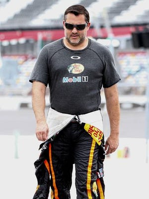 Three-time Sprint Cup champion and Columbus, Ind., native Tony Stewart walks through the pits before practice for the Coke Zero 400 last month at Daytona International Speedway.