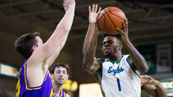Florida Gulf Coast University sophomore, Reggie Reid, attempts to get through the defense during the game against Lipscomb University on Thursday, February 9, 2017 at Alico Arena in Estero.