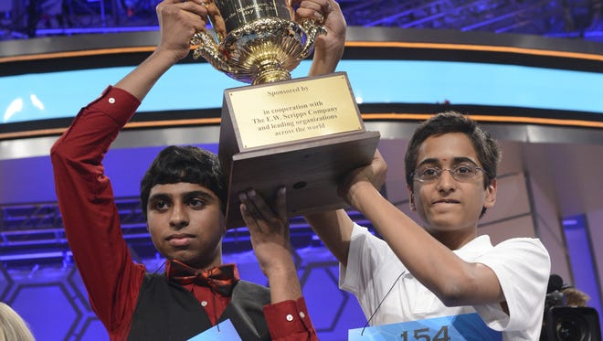 Ansun Sujoe and Sriram Hathwar celebrate being co-champions at the 2014 Scripps National Spelling Bee National Harbor, Md.