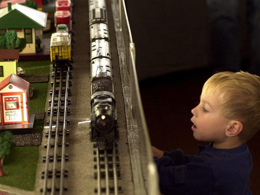 Text: 2000.1124.09.1-DIGITAL IMAGE-KYTRAINS-Samuel Taylor, 2, of Fort Thomas, watches 11/24/00 as one of the trains passes in the Holiday Toy trains exhibit at Behringer-Crawford Museum, Devou Park , Covington. The exhibit opened 11/24 and runs through 1/7