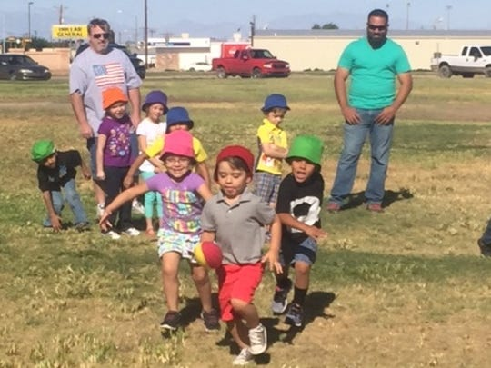 Children in HELP-New Mexico's program play outside.