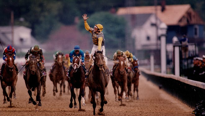 """A jubilant Jerry Bailey crossed the finish line on Sea Hero after charging from behind. """"It was like the Red Sea-every time I got into a position that would be crucial, they would part for me,"""" he said. May 1, 1993"""