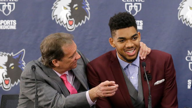 Minnesota Timberwolves draft pick Karl-Anthony Towns, right, shares a laugh with head coach Flip Saunders, left, during a media availability in Minneapolis, Friday, June 26, 2015.  Kentucky center Karl-Anthony Towns was picked No. 1 by the Timberwolves in the NBA draft. (AP Photo/Ann Heisenfelt)