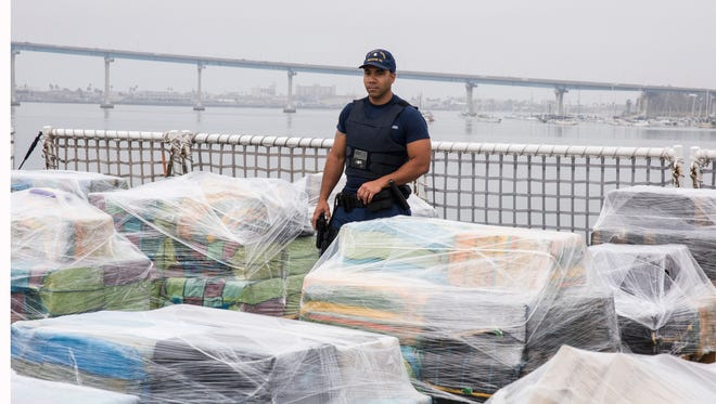 The crew of the Coast Guard Cutter Waesche, homeported in Alameda offloads approximately 18 tons of cocaine in San Diego on June 15, 2017.