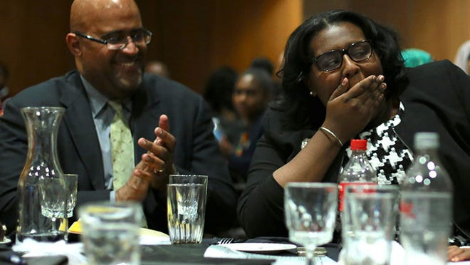 Kayla Cockrel, 17, of Detroit, Cass Tech High School in Detroit is the winner of $24,000 thousands 2015 Ford Motor Company High School Journalism Awards. She shares the moment with her father, former council president Ken Cockrel.