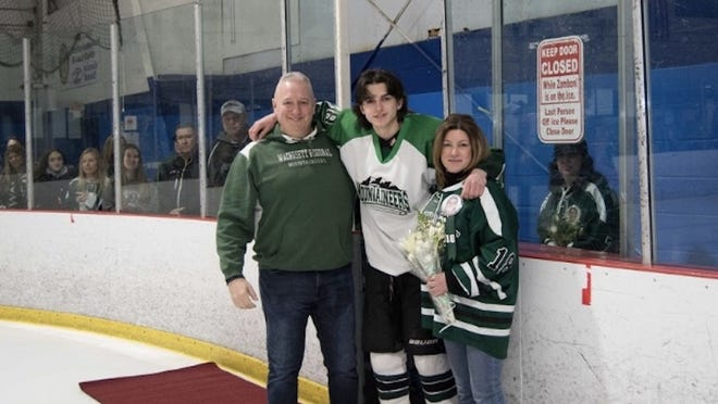 Joey Jusseaume and his parents.
