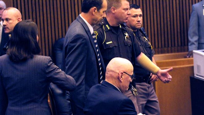Theodore Wafer, left, is lead out of the courtroom after being found guilty of of second-degree murder and manslaughter Thursday, Aug. 7, 2014 in Detroit. Wafer, 55, shot Renisha McBride through a screen door on Nov. 2, hours after she crashed into a parked car a half-mile from his house. The jury convicted Wafer of second-degree murder and manslaughter after deliberating for about eight hours over two days.