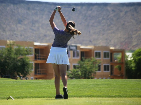 A Desert Hills golfer hits the ball during the 4A state championships at Sunbrook.