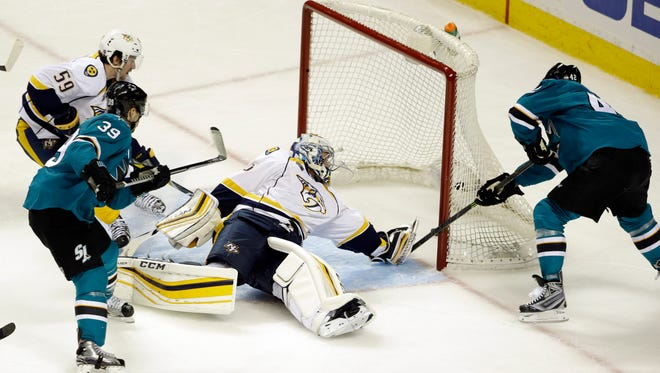 The San Jose Sharks' Joel Ward, right, scores past Nashville Predators goalie Pekka Rinne during the third period of Game 1 in the  Western Conference semifinals on April 29, 2016. San Jose won 5-2.