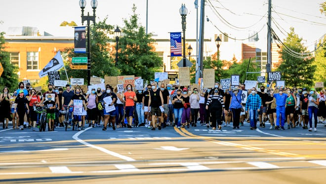 Protestors march up Coddington Street in Quincy demanding equality in support of Black Lives Matter on Sunday, Aug, 30, 2020.  E Gene Chambers/For The Patriot Ledger