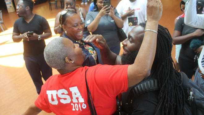 Monica Lockett (bottom left) helps send her son, Kendrick Farris, off to the Olympics in Rio de Janeiro from the Shreveport Regional Airport on Monday.