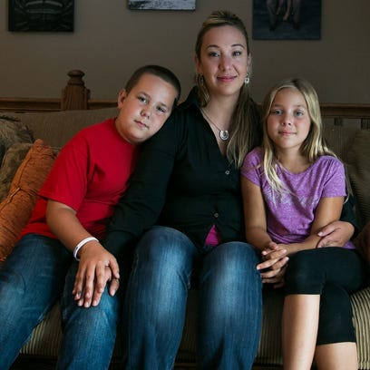 Amanda Buenting with her children Ethan, 11, and Kalie,