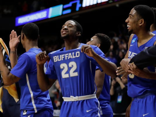 Buffalo guard Dontay Caruthers (22) celebrates on the bench after Buffalo upset Arizona 89-68 in a first-round game in the NCAA men's college basketball tournament Thursday, March 15, 2018, in Boise, Idaho. (AP Photo/Ted S. Warren)
