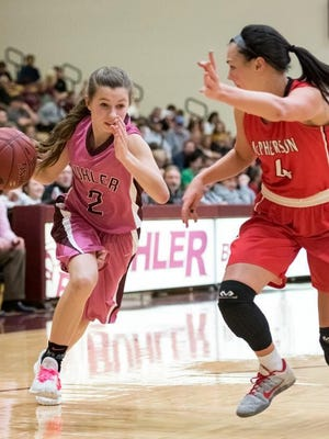 Buhler's Amaleigh Mattison (2) dribbles to the basket past McPherson's Claire Yowell (4) in the third quarter, Friday, Feb. 16, 2018. Mattison is one of three seniors who will lead the Crusaders this season.