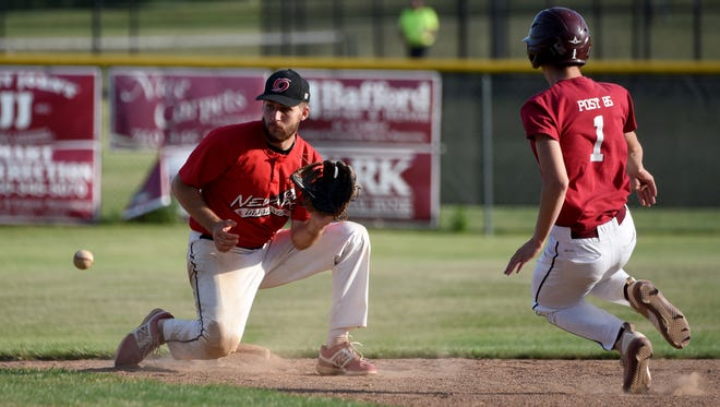 Newark COL team shortstop Zac Morris makes the connection to tag out Newark Legion Post 85 baserunner Zack Watercutter during a game on Wednesday, June 28, 2017.
