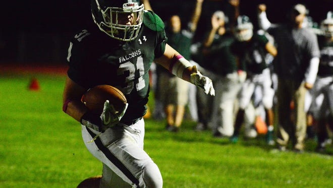 (SPORTS)             10/07/16          So. Plainfield, NJ St. Joes LukeYakely (31) carries the ball for a touchdown against So. Plainfield during first half action on Friday night.   BRI EST 1008 FB St. Joseph at South Plainfield F