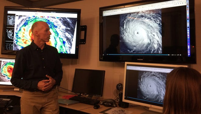 Derrick Herndon, associate researcher in the Tropical Cyclone Research Group at the University of Wisconsin-Madison Space Science and Engineering Center, shows a group of scientists satellite images of Hurricane Irma on Thursday, Sept. 7, 2017.