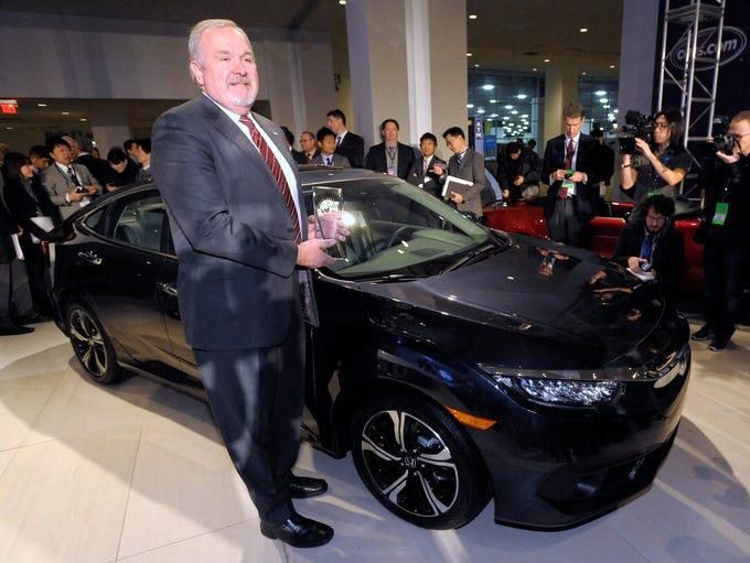 American Honda Executive VP John Mendel poses with