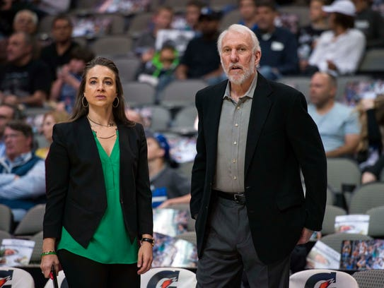 San Antonio Spurs coaches Becky Hammon and Gregg Popovich