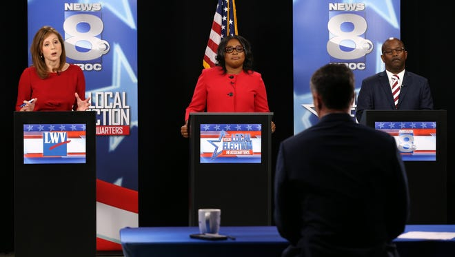 Rachel Barnhart, Rochester Mayor Lovely Warren and James Sheppard during the mayoral debate at WROC.