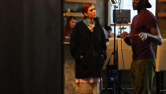 """Shadae Lamar Smith, director of """"Miss Famous,"""" is seen here working behind the scenes with actress Kristen Wiig who plays Monica in the film."""