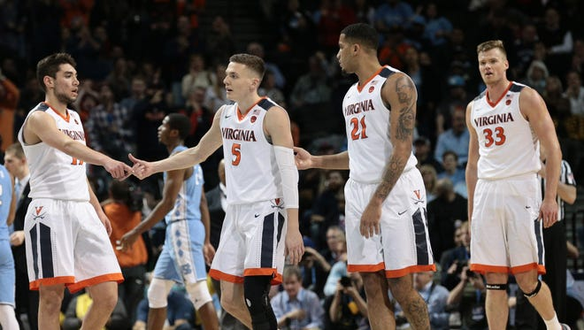 Virginia players, from left to right, Ty Jerome, Kyle Guy, Isaiah Wilkins and Jack Salt celebrate during the second half of their ACC tournament championship victory against North Carolina at Barclays Center in New York.