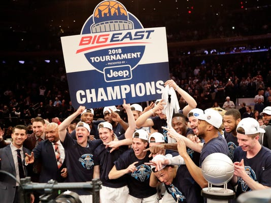 Villanova celebrates after defeating Providence 76-66 in overtime in an NCAA college basketball game in the Big East men's tournament final Saturday, March 10, 2018, in New York. (AP Photo/Frank Franklin II)