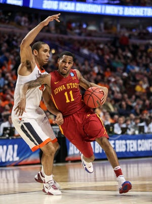 Iowa State's Monte Morris (11) drives to the basket during the regional semifinals of the men's NCAA Tournament, in Chicago Friday, March 25, 2016.