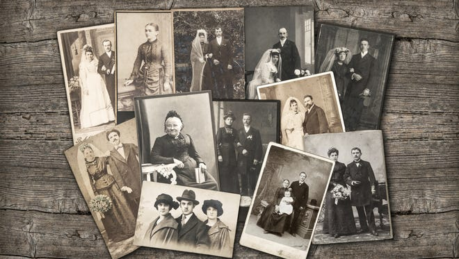 Vintage family photos on shown on a wooden background.