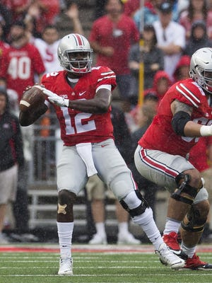 Ohio State quarterback Cardale Jones threw two interceptions before getting benched in the second quarter of Saturday's win over Northern Illinois.