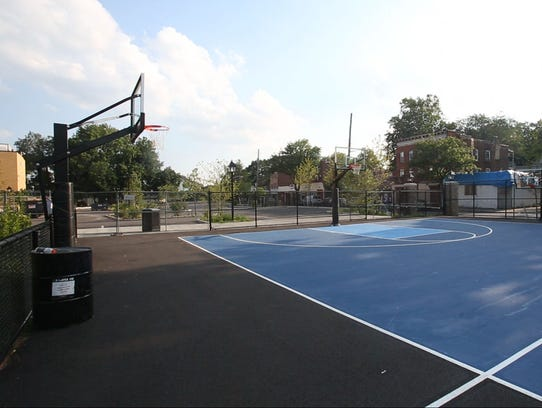 The new basketball court is part of the outdoor playground