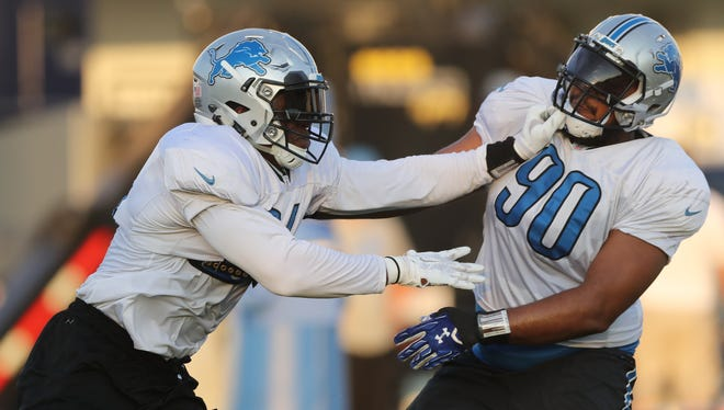 Detroit Lions defensive end Ziggy Ansah rushes against defensive tackle Gabe Wright, right, during drills Aug. 3, 2016, at the practice facility in Allen Park.