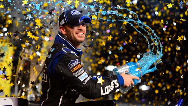 Jimmie Johnson sprays Gatorade in victory lane after winning his Sprint Cup championship Sunday at Homestead-Miami Speedway.
