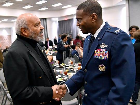 Morris Baker shakes hands with 7th Bomb Wing commander Col. Brandon Parker during Abilene's Martin Luther King, Jr. banquet Jan. 15, 2018. Parker is the first African-American commander of Dyess Air Force Base.