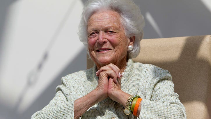 Former first lady Barbara Bush listens to a patient's