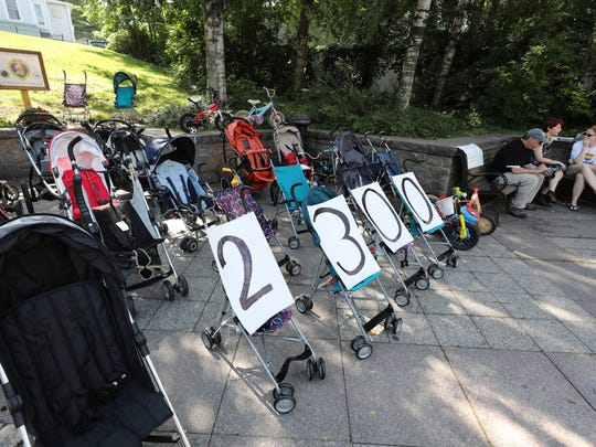 Baby strollers are pictured as a silent rally demonstrating