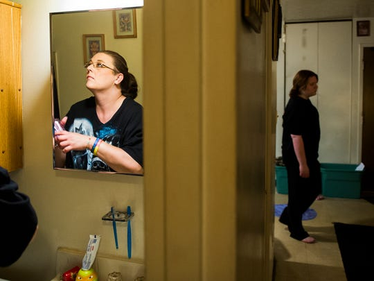 Crystal Causey, left, organizes the bathroom in their apartment as her daughter, Hannah Turner, 16, prepares for her shift at the Henderson Arby's restaurant, Wednesday, June 1, 2016. The family fights for space in their small apartment daily.