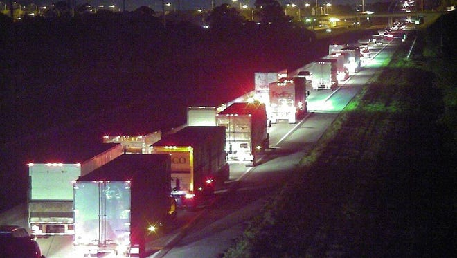 Northbound lanes of Florida's Turnpike are shut down because of a semi-tractor trailer and vehicle crash. Southbound lanes are now open but traffic is heavy.