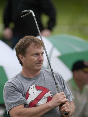 John Cook watched his winning shot end up 3 feet, 5 inches from the hole to win the 2014 Kentucky Derby Festival Hole-in-One contest.