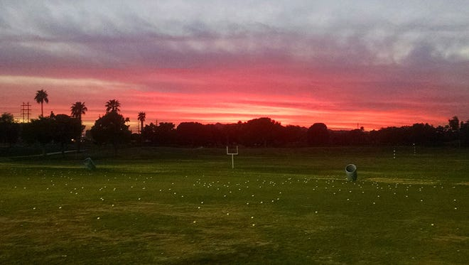 A colorful sunset is par for the course in the Valley of the Sun, as seen from the Ken McDonald Golf Course driving range in Tempe in this photo shared by Brad Schiff.