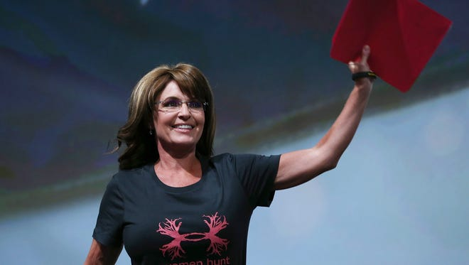 Sarah Palin addresses the NRA wearing a 'Women Hunt' T-Shirt in Houston in May 2013.