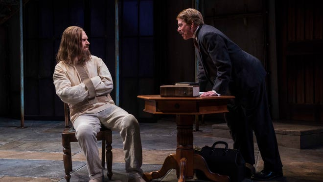 """Norman Moses (right) confronts Grant Goodman in """"Holmes and Watson,"""" performed by Milwaukee Repertory Theater."""