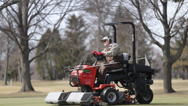 Mike Rank, groundskeeper, grooms a putting green on Thursday at Reid Municipal Golf Course in Appleton. Wm. Glasheen/USA TODAY NETWORK-Wisconsin