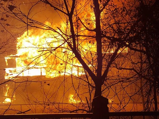Flames consume the River House motel at the corner of River and Ski Mountain roads the night of the Nov. 28, 2016, Gatlinburg wildfire.