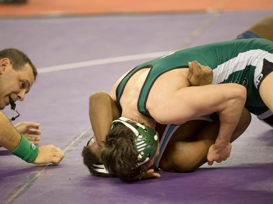South Plainfield's Daniel Hedden goes for a takedown and backpoints on Shawnee's Isaiah Bryant during their 152 lbs match. Friday night Pre-Quarters round at NJSIAA State Wrestling Tournament in Atlantic City, NJ on March 4, 2016