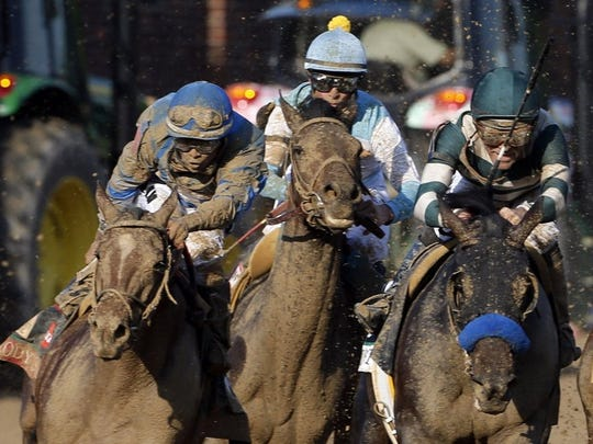 May 7, 2016; Louisville, KY, USA; Luis Saez aboard Brody's Cause (left) races in the pack during the 142nd running of the Kentucky Derby at Churchill Downs. Mandatory Credit: Brian Spurlock-USA TODAY Sports