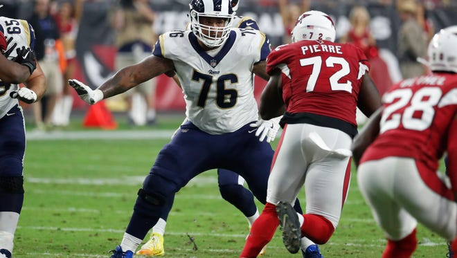 Rams offensive lineman Rodger Saffold (76) readies to pass protect during last Sunday's win at Arizona.