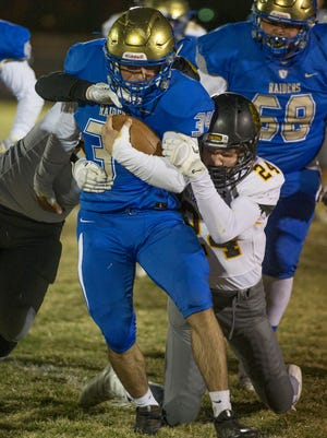 Reed's Christian Richer is tackled by Galena's Aidian Elliott in the second half of their playoff football game on Nov. 9.